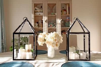 DIY Hurricane Lanterns Out of Dollar Store Frames